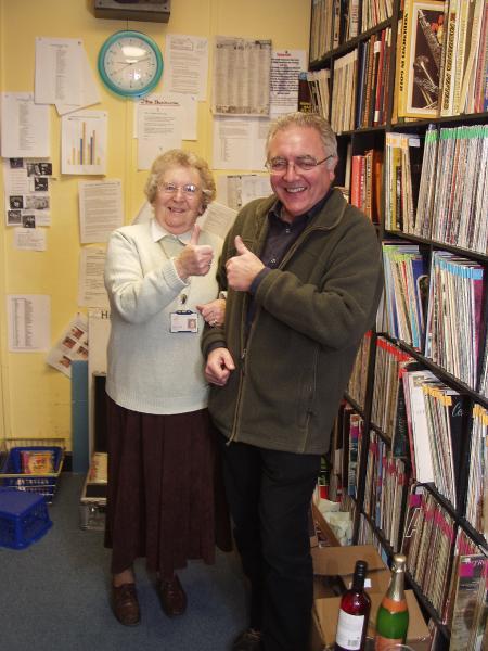 Photograph shows Gwenda Gibson & John Alborough in the HRI Library