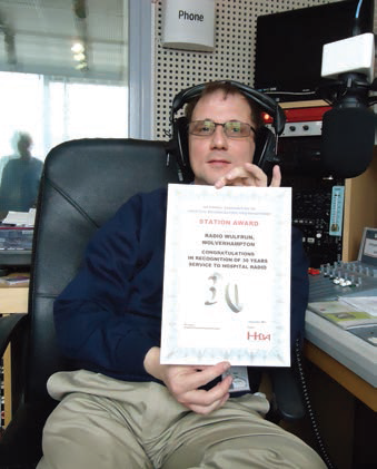 Radio Wulfrun chairman Richard Stanton with the stations 20 year certificate