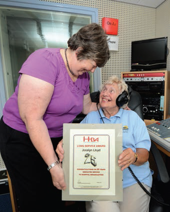 June Snowden presents Jocelyn Lloyd with her 25 year certificate